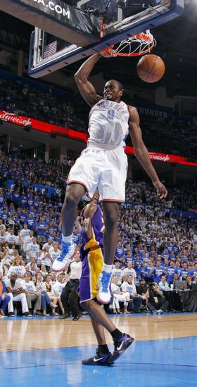 Oklahoma City's Serge Ibaka dunks the ball over Los Angeles' Kobe Bryant during Game 2 in the second round of the NBA playoffs between the Oklahoma City Thunder and L.A. Lakers at Chesapeake Energy Arena in Oklahoma City, Wednesday, May 16, 2012. Photo by Bryan Terry, The Oklahoman
