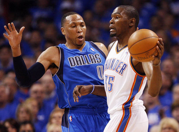 Oklahoma City's Kevin Durant (35) passes the ball away from Dallas' Shawn Marion (0) during game one of the first round in the NBA playoffs between the Oklahoma City Thunder and the Dallas Mavericks at Chesapeake Energy Arena in Oklahoma City, Saturday, April 28, 2012. Photo by Nate Billings, The Oklahoman