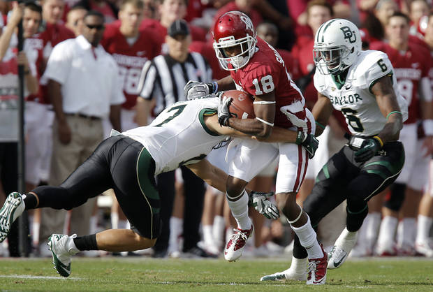 Baylor&#039;s Darius Jones (7) and Ahmad Dixon (6) go after Oklahoma&#039;s Jalen Saunders (18) during the college football game between the University of Oklahoma Sooners (OU) and Baylor University Bears (BU) at Gaylord Family - Oklahoma Memorial Stadium on Saturday, Nov. 10, 2012, in Norman, Okla.  Photo by Chris Landsberger, The Oklahoman