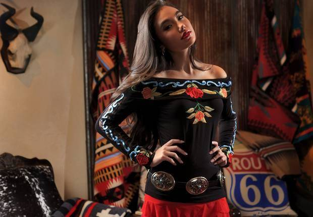 Vintage Collection embroidered off-the-shoulder top, Vintage Collection mermaid skirt and Barbosa concho belt from Filigree. Model is Adrianna. Photo by Chris Landsberger, The Oklahoman