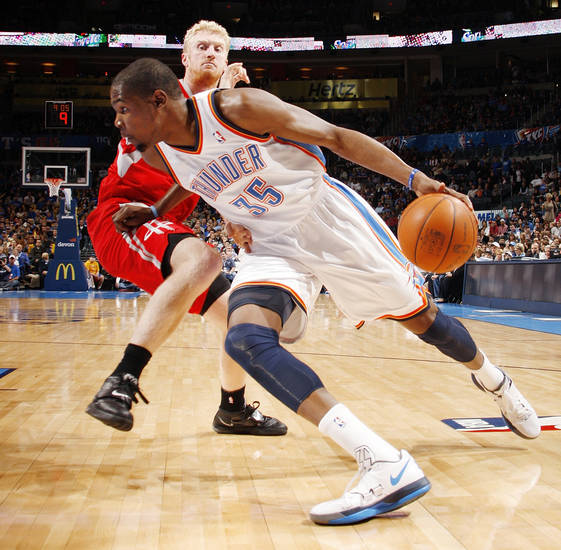 Oklahoma City's Kevin Durant (35) drives to the basket past Chase Budinger (10) of Houston in the first quarter during the NBA basketball game between the Oklahoma City Thunder and the Houston Rockets at Chesapeake Energy Arena in Oklahoma City, Friday, Jan. 6, 2012. Photo by Nate Billings, The Oklahoman