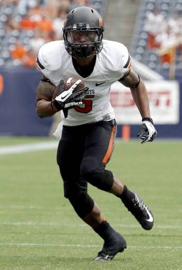 Oklahoma State's Josh Stewart (5) runs after a catch during second half of the AdvoCare Texas Kickoff college football game between the Oklahoma State University Cowboys (OSU) and the Mississippi State University Bulldogs (MSU) at Reliant Stadium in Houston, Saturday, Aug. 31, 2013. Photo by Sarah Phipps, The Oklahoman