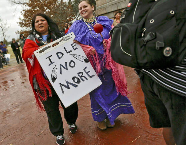 Carmen Thompson and Paulette Blanchard, from left, carries signs during a rally on the north side of the state Capitol for Native American rights on Monday, Jan. 28, 2013, in Oklahoma City, Okla.  Photo by Chris Landsberger, The Oklahoman