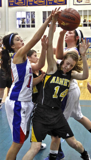 Arnett's Mattie Atha (14) battles for the ball with Hammon's Kala Morris (10) during the Class B Girls State Basketball Championship game between Hammon and Arnett on Thursday, March 1, 2012 in Choctaw, Okla.  Photo by Chris Landsberger, The Oklahoman