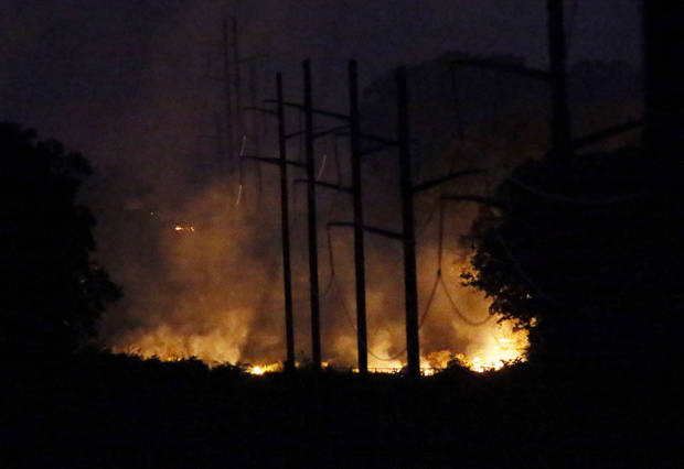 Flames are seen looking east from SE 156th near Post Oak Rd. as a wildfire burns through Cleveland County near Norman, Okla., Friday, Aug. 3, 2012. Photo by Nate Billings, The Oklahoman