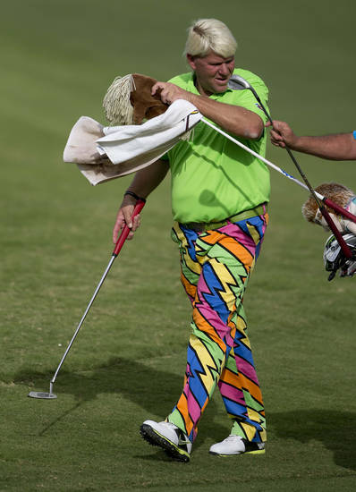 John Daly takes a club from his caddie on the 16th fairway during the second round of the Justin Timberlake Shriners Hospitals for Children Open golf tournament on Friday, Oct. 5, 2012, in Las Vegas. (AP Photo/Julie Jacobson)