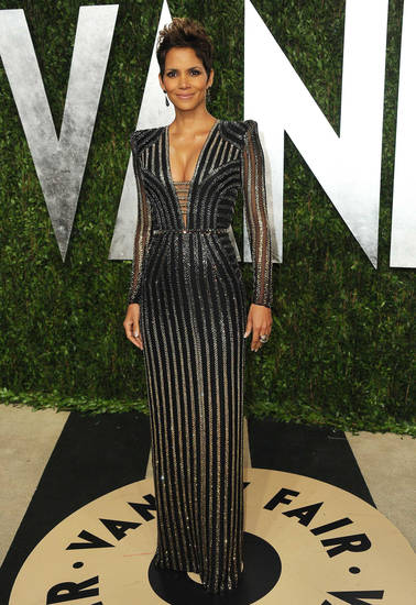 Actress Halle Berry, wearing  Versace, arrives at the 2013 Vanity Fair Oscar party on Sunday, Feb. 24 2013 at the Sunset Plaza Hotel in West Hollywood, Calif. (Photo by Jordan Strauss/Invision/AP) <strong>Jordan Strauss</strong>