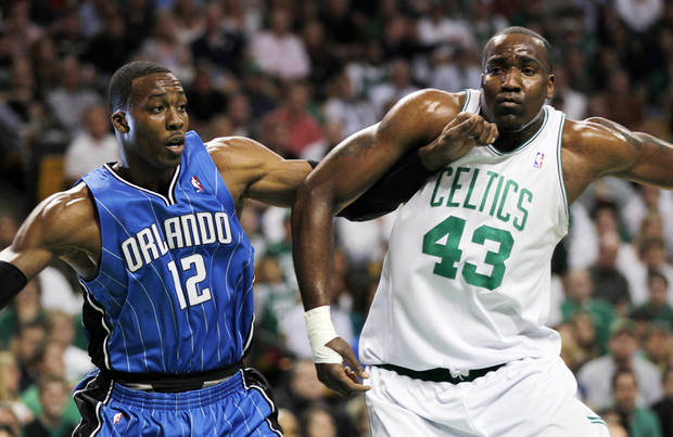 Orlando Magic center Dwight Howard (12) and Boston Celtics center Kendrick Perkins (43) jockey for position during the first quarter in Game 6 of the NBA Eastern Conference basketball finals in Boston, Friday, May 28, 2010. (AP Photo/Charles Krupa)