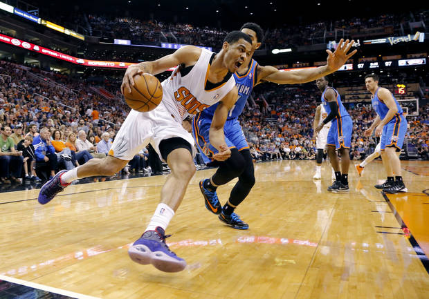 Phoenix Suns guard Gerald Green, front, drives the baseline as Oklahoma City Thunder guard Jeremy Lamb defends during the first half of an NBA basketball game Sunday, April 6, 2014, in Phoenix. The Suns won 122-115. (AP Photo/Matt York)