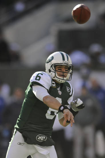 "FILE - In this Dec. 24, 2011, file photo, New York Jets' Mark Sanchez throws the ball during the first quarter of an NFL football game against the New York Giants in East Rutherford, N.J. The Jets have extended quarterback Sanchez's contract and dropped out of pursuing free agent Peyton Manning. The team announced the extension for Sanchez in a conference call Friday night, March 9, 2012, and general manager Mike Tannenbaum says the Jets ""looked at"" going after Manning before deciding to stick with Sanchez. (AP Photo/Bill Kostroun, File)"