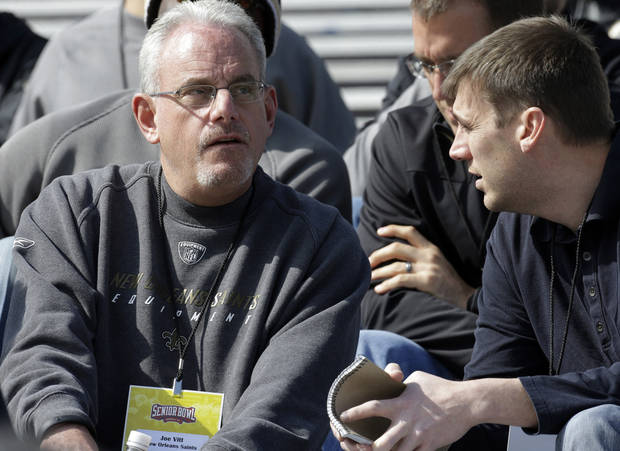 New Orleans Saints assistant head coach Joe Vitt, left, talks with an associate during Senior Bowl football practice at Ladd-Peebles Stadium in Mobile, Ala., Tuesday, Jan. 22, 2013. Vitt served as head coach during the season long suspension of head coach Sean Payton. (AP Photo/Dave Martin)