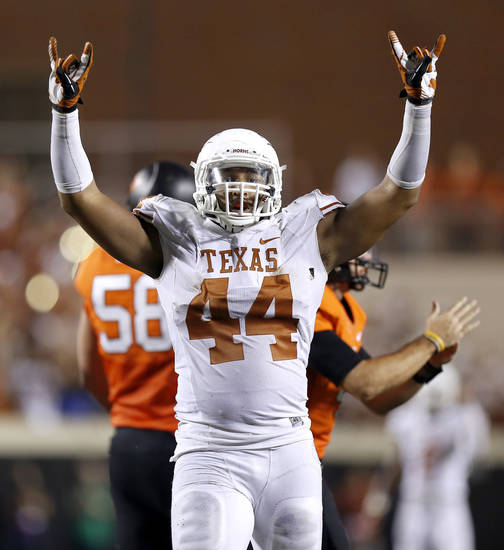 Texas&#039; Jackson Jeffcoat (44) celebrates during a college football game between Oklahoma State University (OSU) and the University of Texas (UT) at Boone Pickens Stadium in Stillwater, Okla., Saturday, Sept. 29, 2012. Oklahoma State lost 41-36. Photo by Bryan Terry, The Oklahoman
