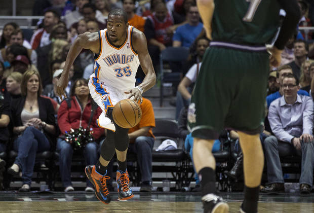 Oklahoma City Thunder's Kevin Durant brings the ball upcourt against the Milwaukee Bucks during the first half of an NBA basketball game on Saturday, March 30, 2013, in Milwaukee. (AP Photo/Tom Lynn) ORG XMIT: WITL108