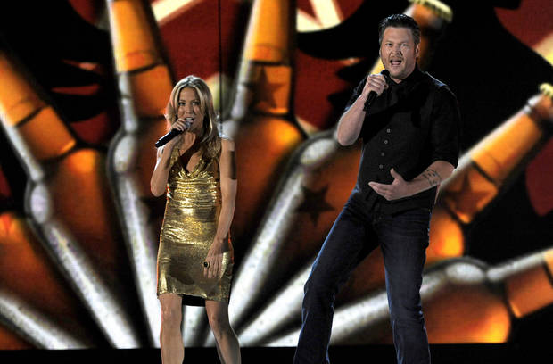 Sheryl Crow, left, and Blake Shelton perform at the 48th Annual Academy of Country Music Awards at the MGM Grand Garden Arena in Las Vegas on Sunday, April 7, 2013. (Photo by Chris Pizzello/Invision/AP) ORG XMIT: NVPM201