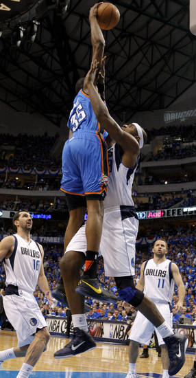 Thunder forward Kevin Durant got the jump on Mavericks center Brendan Haywood in more ways than one. He jumped earlier and higher. Photo by Bryan Terry, The Oklahoman ORG XMIT: KOD