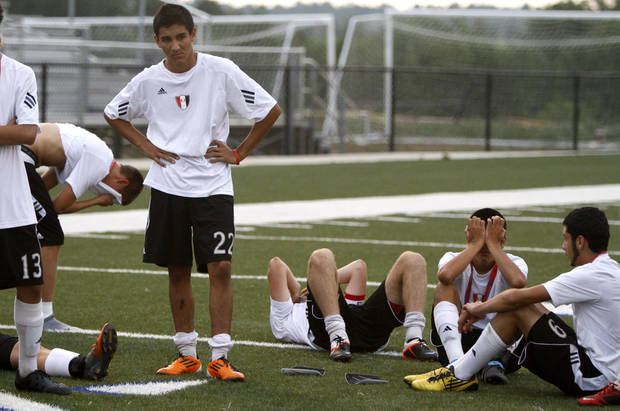 The Tulsa Union team, including Brian Castaneda, at left, react after losing the boys 6A state championship soccer game in Newcastle, Okla., Saturday, May 12, 2012. Photo by Bryan Terry, The Oklahoman