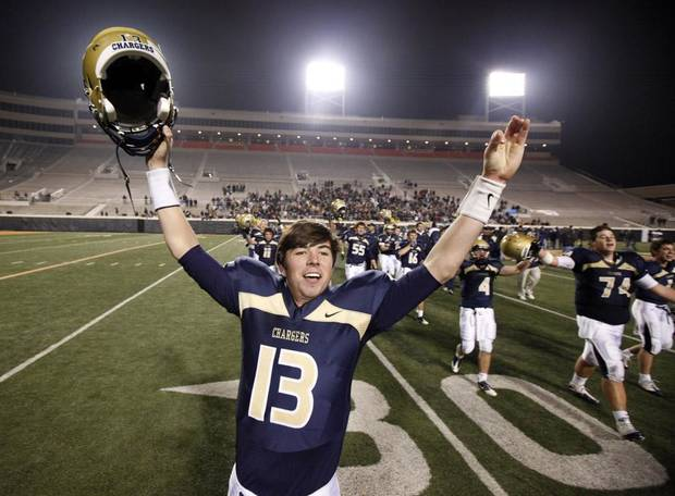 Heritage Hall's Cooper Cloud celebrates after Heritage Hall's 28-21 win in the Class 3A high school football state championship game against Kingfisher at Boone Pickens Stadium in Stillwater, Okla., Friday, December 10, 2010. By Bryan Terry, The Oklahoman ORG XMIT: KOD
