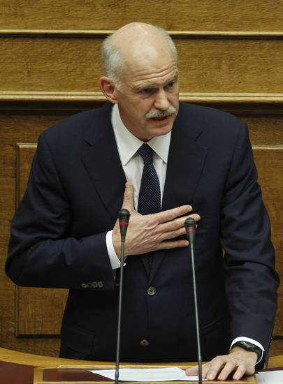 Greek Prime Minister George Papandreou speaks during a parliament session in Athens, on Thursday, Nov. 3, 2011. Papandreou abandoned his explosive plan to put a European rescue deal to popular vote Thursday, keeping his government alive _ but passionate squabbling in Athens left the country's solvency in doubt and the eurozone in turmoil. Greek Prime Minister reversed course after a rebellion within his own Socialist party over the referendum, but ignored repeated calls to resign and call elections. (AP Photo/Petros Giannakouris) ORG XMIT: XPG119
