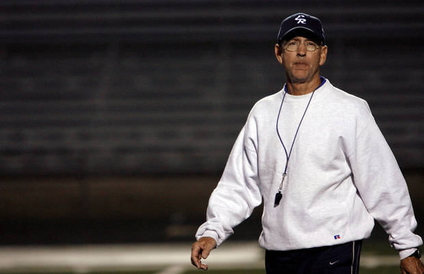 El Reno High School football coach Tom Cobble watches as the El Reno football team practices at Yukon High School on Tuesday, Nov. 25, 2008, in Yukon, Okla. El Reno was getting some practice time on the artificial turf before playing this week&#039;s semifinal playoff game at Mustang High School.   STAFF PHOTO BY CHRIS LANDSBERGER  ORG XMIT: KOD
