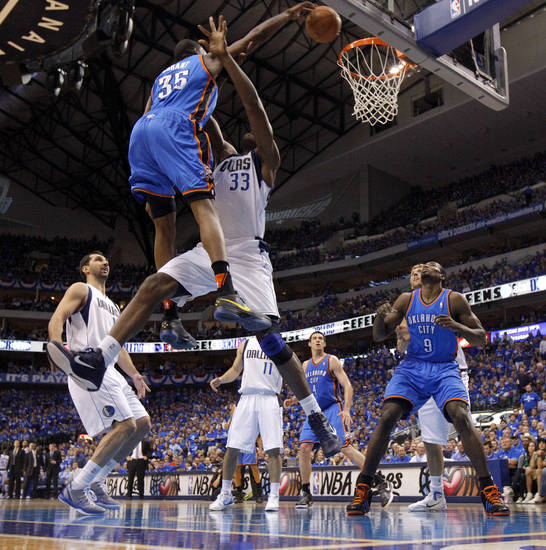 Not only did flush the ball into the basket, Oklahoma City's Kevin Durant (35) is fouled by Dallas center Brendan Haywood (33) on the play. Photo by Bryan Terry, The Oklahoman ORG XMIT: KOD