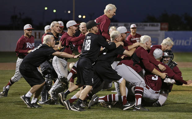 Owasso celebrates beating Norman North in the Class 6A state baseball tournament championship game in Shawnee, Okla., Saturday, May 11, 2013. Photo by Bryan Terry, The Oklahoman