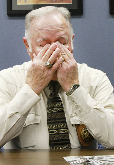 Retired Oklahoma State Trooper Col. Mike Grimes covers his eyes as he talks about his brother Lt. Pat Grimes who was killed in 1978 while trying to apprehend two prison escapees from McAlester, Friday, December 2 , 2011.       Photo by David McDaniel, The Oklahoman  ORG XMIT: KOD