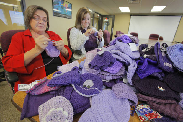"Penny Hill-Malone and Aimee Merick crochet purple caps for the ""Click for Babies"" program to raise awareness about normal infant crying and the dangers of shaking a baby. Photo by David McDaniel, The Oklahoman"