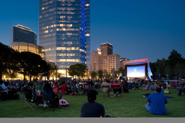 Crowds gather on the grand lawn at Myriad Gardens last week to watch �Under African Skies,� a documentary screened as part of the deadCenter Film Festival. Photo Provided by deadCenter Film Festival