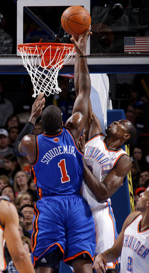 Oklahoma City's Serge Ibaka (9) blocks the shot of New York's Amare Stoudemire (1) during the NBA game between the Oklahoma City Thunder and the New York Knicks at Chesapeake Energy Arena in Oklahoma CIty, Saturday, Jan. 14, 2012. Photo by Bryan Terry, The Oklahoman