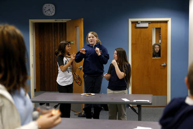 Above: Abbey Joshi, 11, left, Katherine Lorenz, 12, and McKenzie Bruton, 12, react as results are announced in the Teen Iron Chef Chocolate Challenge.