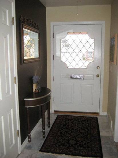 Sunita Sitara, a Feng Shui consultant, painted the wall in her entryway a dark espresso. Color is an important aspect of Feng Shui for your home. Dark colors in your home's entryway help positive chi to enter your home, she says. Photo provided. <strong></strong>