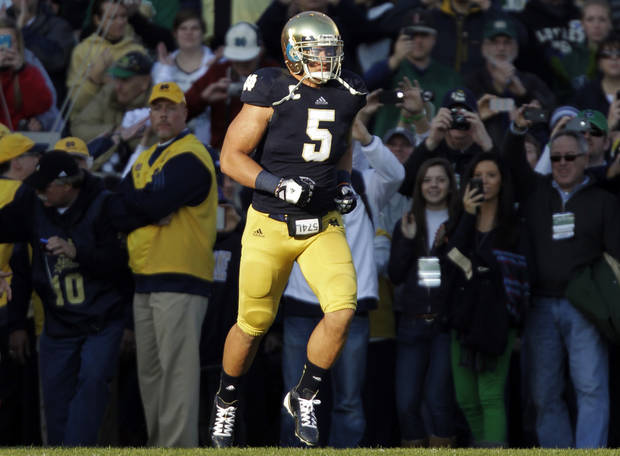 FILE - In this Nov. 17, 2012, file photo, Notre Dame linebacker Manti Te'o takes the field during senior day before an NCAA college football game against Wake Forest in South Bend, Ind. The wrenching story of Te'o's girlfriend dying of leukemia _ a loss he said inspired him to play his best all the way to the BCS championship _ was dismissed by the school Wednesday, Jan. 16, 2013, as a hoax perpetrated against the linebacker. (AP Photo/Michael Conroy, File)