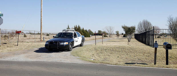 A police cruiser blocks the driveway of a house in the 11000 block of S Bryant Wednesday where Gerald David Hume was arrested after an 11-hour standoff. Photo by Paul B. Southerland, The Oklahoman