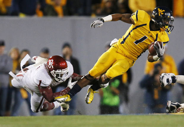Oklahoma&#039;s Tony Jefferson (1) trips up West Virginia&#039;s Tavon Austin (1) in the first quarter during a college football game between the University of Oklahoma (OU) and West Virginia University on Mountaineer Field at Milan Puskar Stadium in Morgantown, W. Va., Nov. 17, 2012. Photo by Nate Billings, The Oklahoman