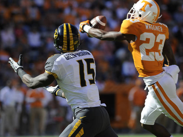 Tennessee defensive back Prentiss Waggner (23) intercepts a pass meant for Missouri wide receiver Dorial Green-Beckham (15) during the first quarter of an NCAA football game at Neyland Stadium, Saturday, Nov. 10, 2012, in Knoxville, Tenn. (AP Photo/Knoxville News Sentinel, Amy Smotherman Burgess)