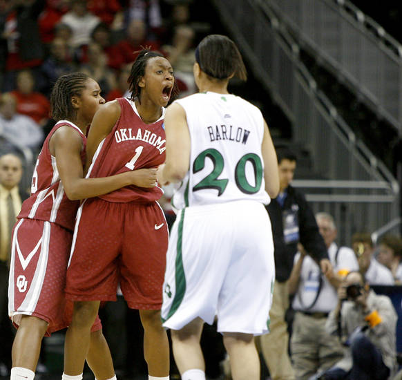 OU's Nyeshia Stevenson and Jasmine Hartman, left, celebrate after Stevenson made a basket in the final seconds overtime in the Sweet 16 round of the NCAA women's  basketball tournament in Kansas City, Mo., on Sunday, March 28, 2010. 