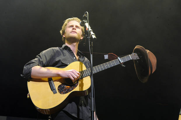 FILE - This Dec. 8, 2012 file photo shows Wesley Schultz of The Lumineers performing at KROQ Almost Acoustic Christmas in Los Angeles.  The Lumineers', �Ho Hey� was the top streamed track on Spotify for the week of Dec. 3. (Photo by Katy Winn/Invision/AP, file)