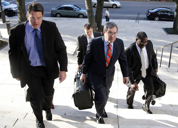 Jeffrey Kessler, center, lead counsel for New Orleans Saints defensive end Will Smith, and former Saints' Scott Fujita, left, and Anthony Hargrove, right, arrive for appeal hearings in the NFL's bounty investigation of the Saints football team, Monday, Dec. 3, 2012, in New Orleans. (AP Photo/The Times-Picayune, Ted Jackson) MAGS OUT; NO SALES; USA TODAY OUT