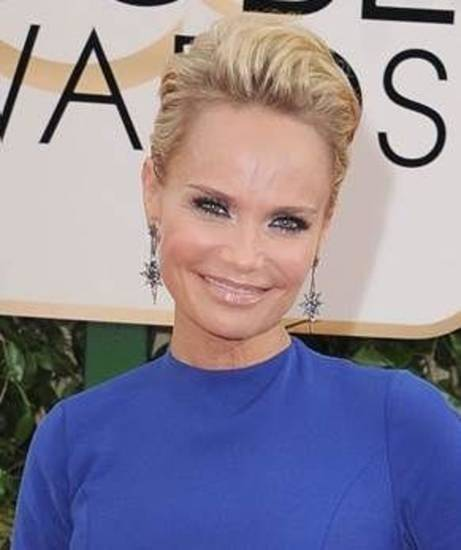 Kristin Chenoweth arrives at the 71st annual Golden Globe Awards at the Beverly Hilton Hotel on Sunday, Jan. 12, 2014, in Beverly Hills, Calif. (AP file)