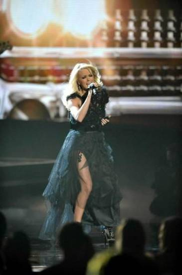 "Carrie Underwood performs ""Two Black Cadillacs"" at the 40th Anniversary American Music Awards on Sunday, Nov. 18, 2012, in Los Angeles."