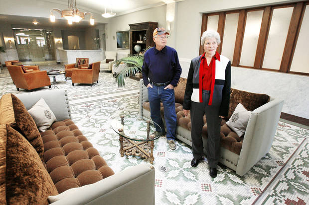 Robert Sieber's grandchildren Ray McMinn, left, and Joanie Elder, right, look at the renovated lobby of Sieber Hotel on Jan. 19. photo BY PAUL B. SOUTHERLAND, THE OKLAHOMAN
