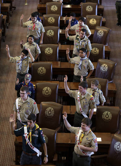 Boy Scouts recite the Scout Oath during the annual Boy Scouts Parade and Report to State in the House Chambers at the Texas capitol, Saturday, Feb. 2, 2013, in Austin, Texas. Gov. Rick Perry said emphatically Saturday that the Boy Scouts of America shouldn't soften its strict no-gays membership policy, and suggested that bending the organization to the whims of popular culture is wrong.(AP Photo/Eric Gay)