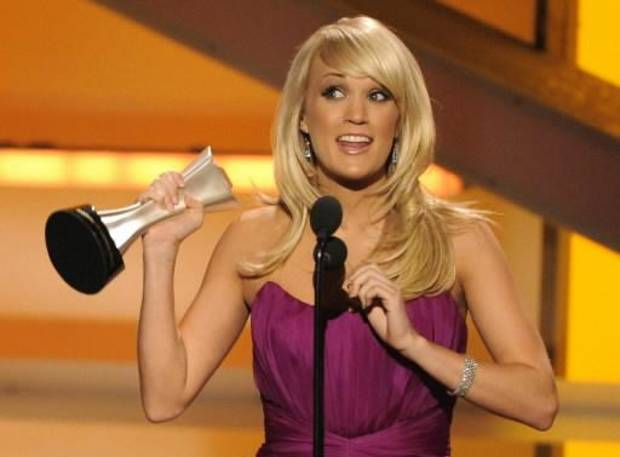 Oklahoma native Carrie Underwood accepts a 2008 Academy of Country Music Award. (Associated Press photo)