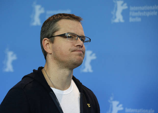 Actor Matt Damon poses at the photo call for the film Promised Land at the 63rd edition of the Berlinale, International Film Festival in Berlin, Friday, Feb.8,2013. (AP Photo/Gero Breloer)