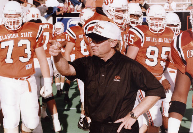 "COLLEGE FOOTBALL: ""OSU coach Pat Jones leads the linemen onto the field for pre-game drill"" as the Oklahoma State University Cowboys hosted the Tulsa Hurricane.  OSU prevailed, 24-19. Staff photo by Doug Hoke taken 9/26/92; photo ran in the 9/27/92 Daily Oklahoman."