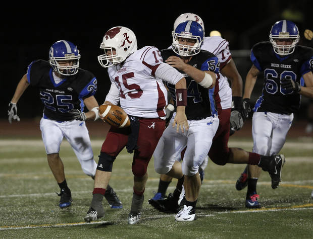 Ardmore's Clay Atwood (15) runs the ball during a high school football game between Deer Creek and Ardmore at Deer Creek Stadium in Edmond, Okla., Friday, Nov. 9, 2012.  Photo by Garett Fisbeck, The Oklahoman