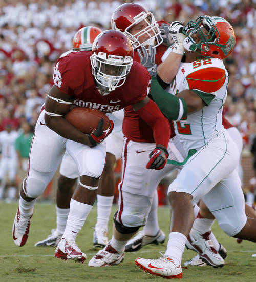 Oklahoma's runs for a touchdown Damien Williams (26) during the college football game between the University of Oklahoma Sooners (OU) and Florida A&M Rattlers at Gaylord Family�Oklahoma Memorial Stadium in Norman, Okla., Saturday, Sept. 8, 2012. Photo by Bryan Terry, The Oklahoman