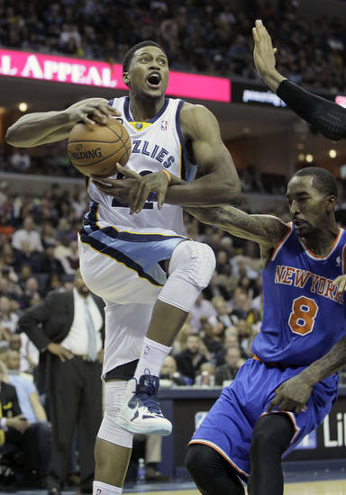 Memphis Grizzlies' Rudy Gay, top, is fouled by New York Knicks' J.R. Smith (8) during the second half of an NBA basketball game in Memphis, Tenn., Friday, Nov. 16, 2012. The Memphis Grizzlies defeated the New York Knicks 105-95. (AP Photo/Danny Johnston)