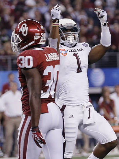 Texas A&M's Ben Malena (1) celebrates a touchdown in front of Oklahoma's Javon Harris (30) during the college football Cotton Bowl game between the University of Oklahoma Sooners (OU) and Texas A&M University Aggies (TXAM) at Cowboy's Stadium on Friday Jan. 4, 2013, in Arlington, Tx. Photo by Chris Landsberger, The Oklahoman