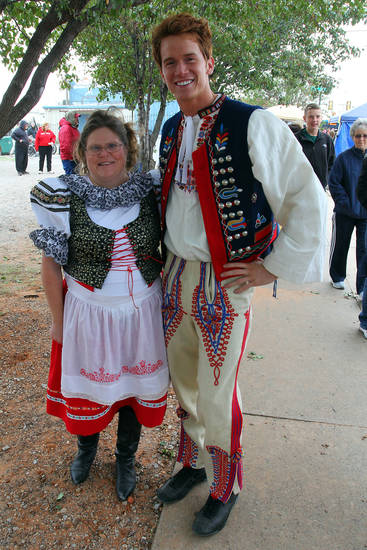 Stacey Ratcliff of Yukon and Karl Francel of Piedmont wear traditional clothing during the 47th annual Czech Festival Saturday in Yukon. PHOTO BY HUGH SCOTT FOR THE OKLAHOMAN